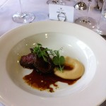 Peppered crusted venison with parsnip truffle puree and pinot jus