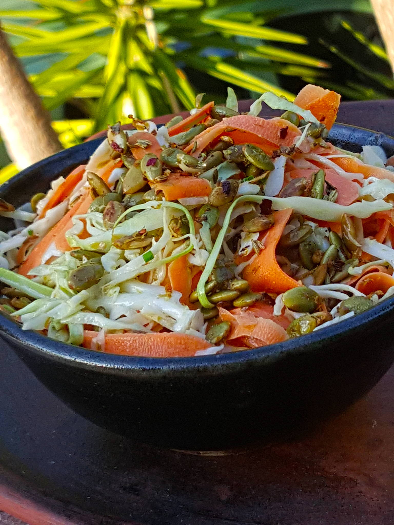 Cabbage & Carrot Slaw with Spicy Pepita Topping