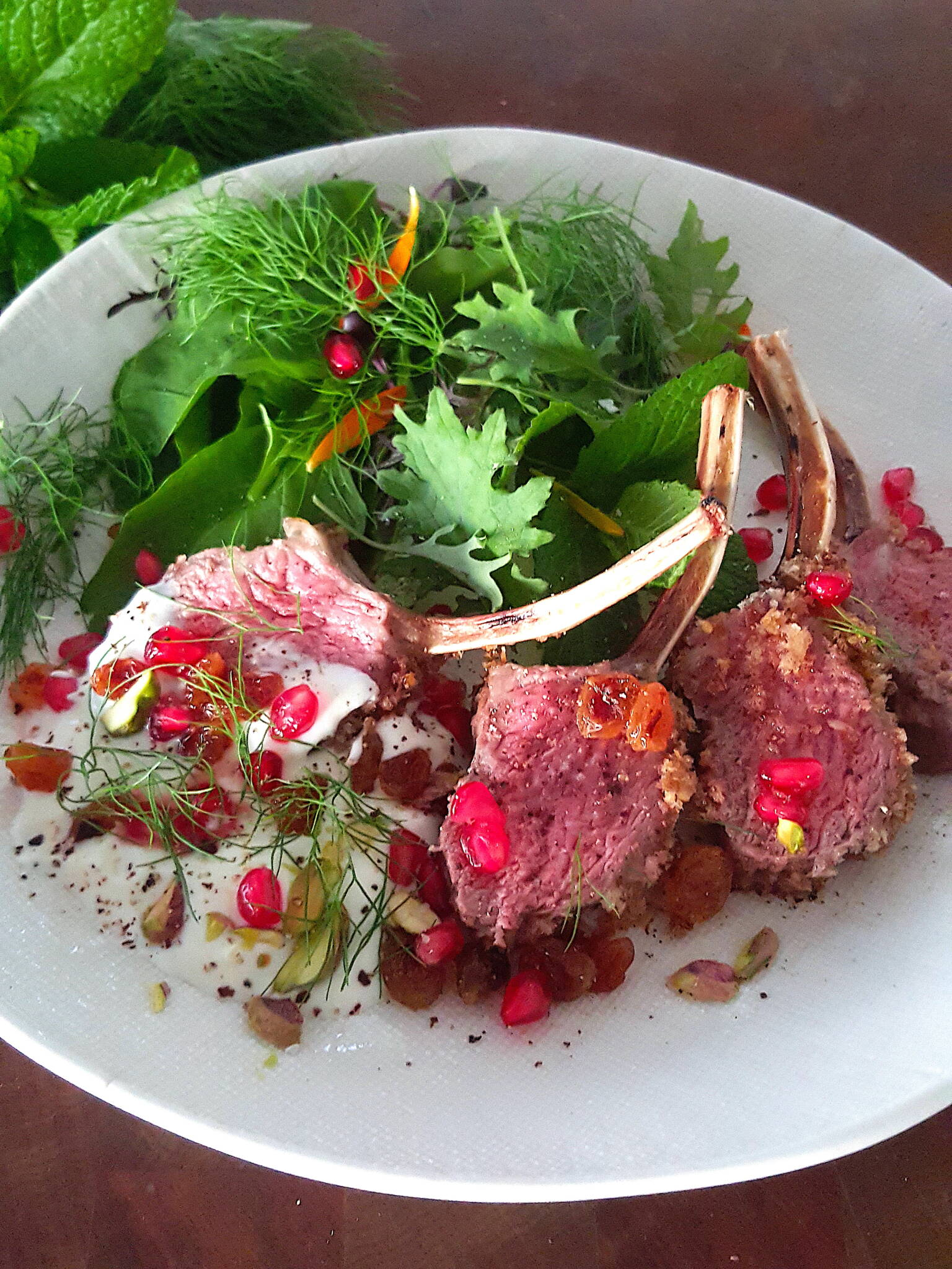 Stunning lamb rack with cardamom, pistachio & pomegranate