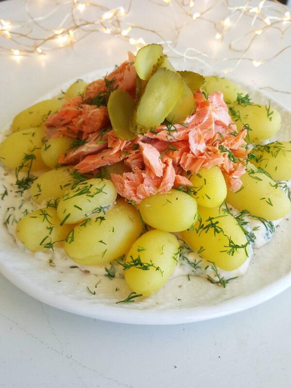 Top baby potatoes & horseradish Sauce with hot-smoked salmon