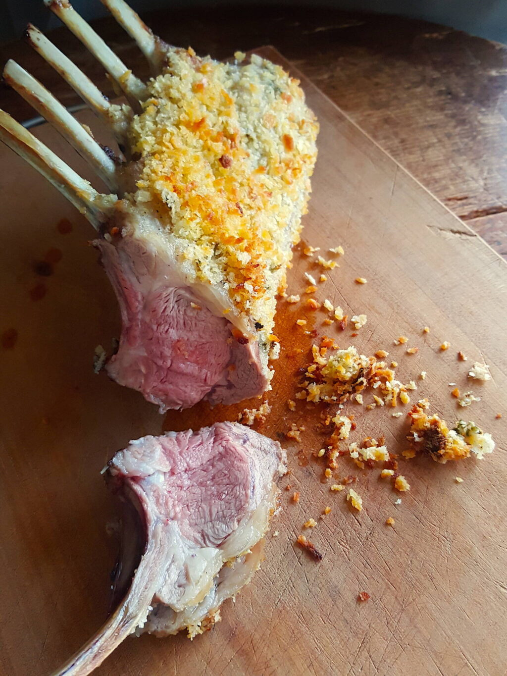 Crusted Lamb Racks with Roasted Grapes