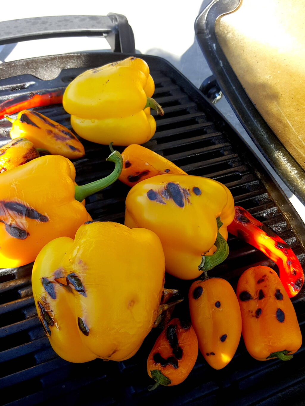 Grilling peppers until charred